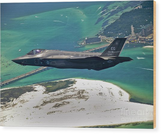 Wood Print featuring the photograph An F-35 Lightning II Flies Over Destin by Stocktrek Images