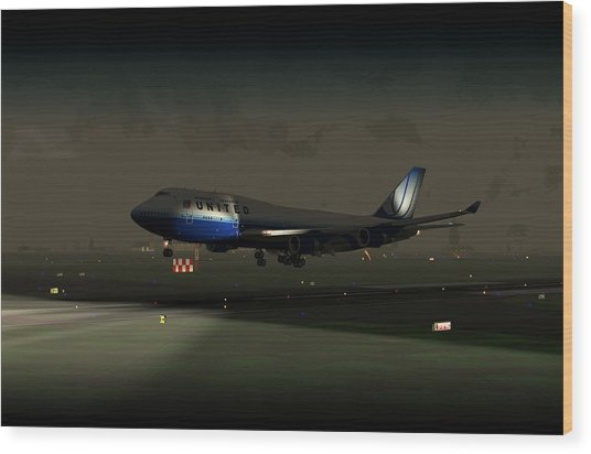 B747-400 Night Landing Wood Print by Mike Ray