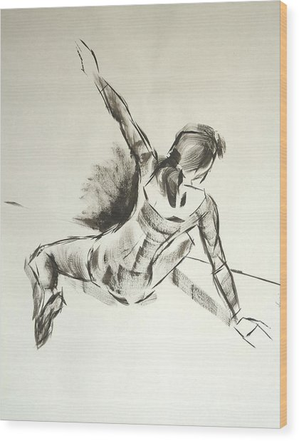 Ballet Dancer Sitting On Floor With Weight On Her Right Arm Wood Print