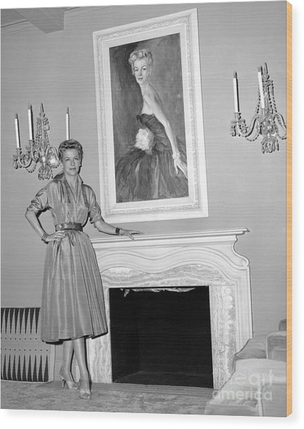 Beauty, Betty Furness, Poses With Her Likeness Behind Her. 1956 Wood Print by Anthony Calvacca