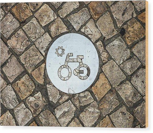 Bike Path Sign On A Cobblestone Pavement Wood Print