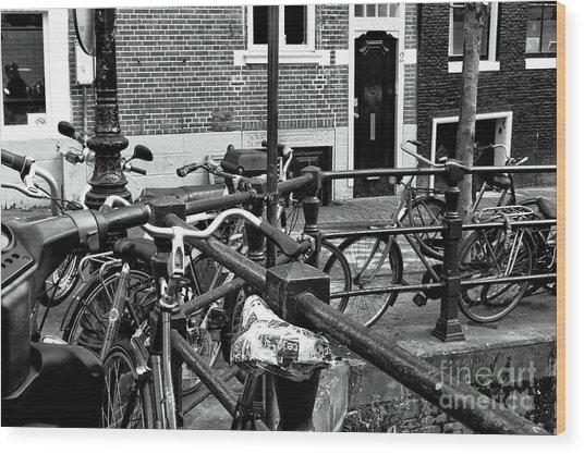 Bikes Hanging Out Mono Wood Print by John Rizzuto