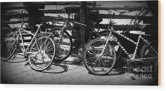 Black And White Leaning Bikes Wood Print by Emily Kelley