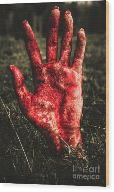Blood Stained Hand Coming Out Of The Ground At Night Wood Print