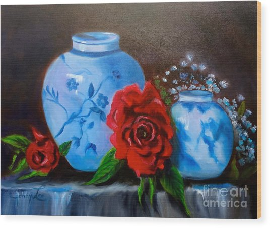Blue And White Pottery And Red Roses Wood Print