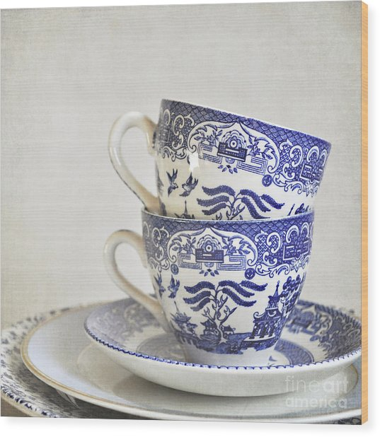Blue And White Stacked China. Wood Print