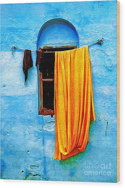 Blue Wall With Orange Sari Wood Print by Derek Selander