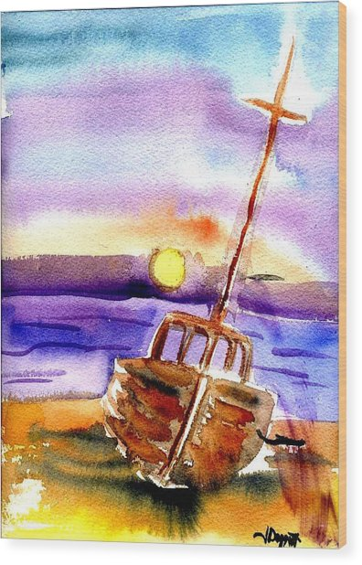 Boat Ashore Wood Print by Janet Doggett