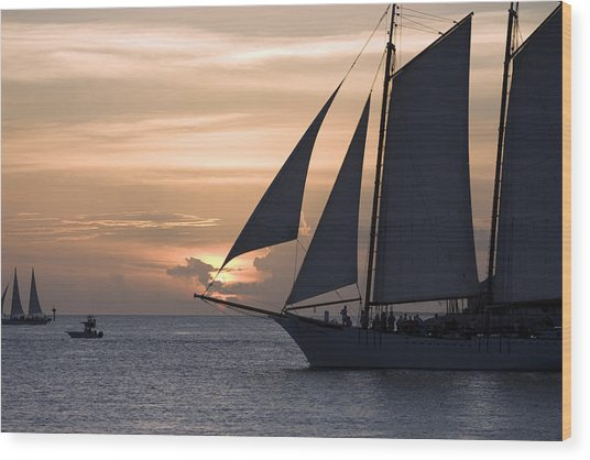 Boats Passing Through Florida Keys Sunset Wood Print by Christopher Purcell