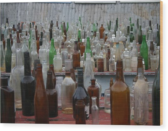 Bottles Wood Print by Dennis Curry
