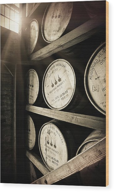 Bourbon Barrels By Window Light Wood Print by Karen Varnas