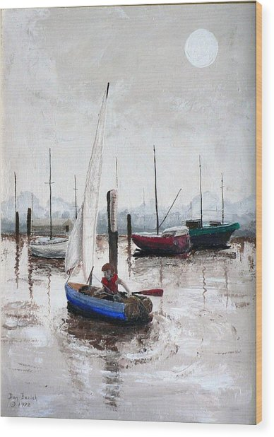 Boy In Blue Sailboat Wood Print by Dan Bozich