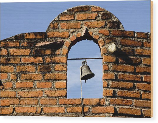 Brick Wall And Bell Wood Print by Xavier Cardell
