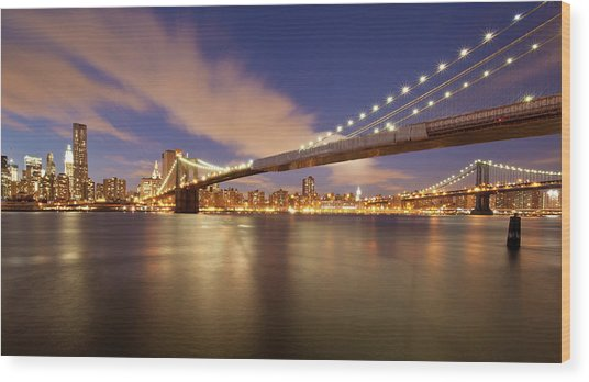 Brooklyn Bridge And Manhattan At Night Wood Print by J. Andruckow