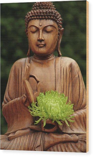 Buddha Statue Holding Flower Wood Print