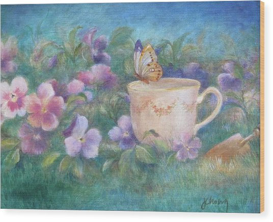 Butterfly On Teacup Wood Print