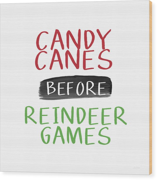 Candy Canes Before Reindeer Games- Art By Linda Woods Wood Print