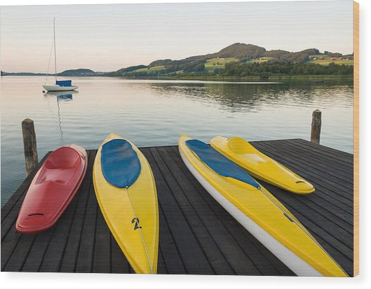 Canoes On Pier In A Tranquil Afternoon Wood Print