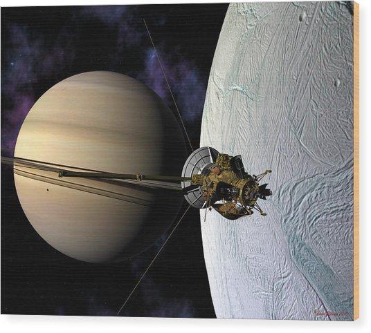 Cassini Passing Enceladus  Wood Print