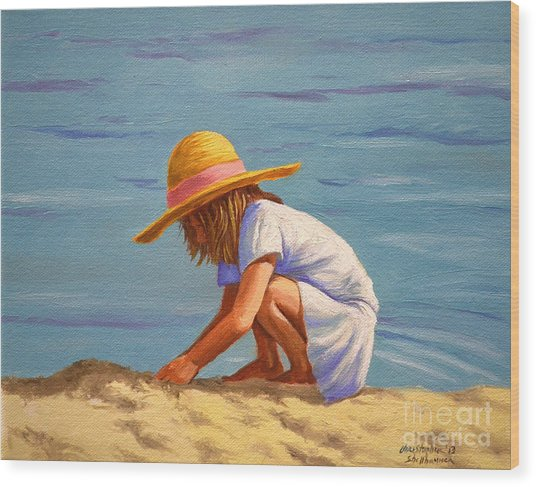 Child Playing In The Sand Wood Print