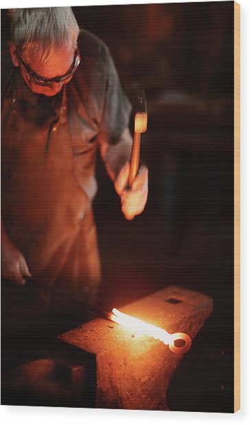 Close-up Of  Blacksmith Forging Hot Iron Wood Print