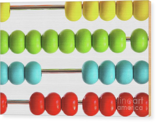 Closeup Of Bright  Abacus Beads On White Wood Print