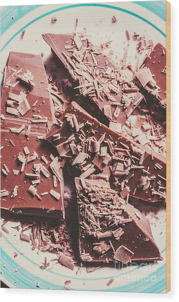 Closeup Of Chocolate Pieces And Shavings On Plate Wood Print