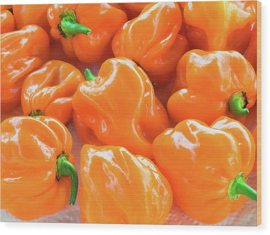 Closeup Of Fresh Chillies Habanero Orange Wood Print