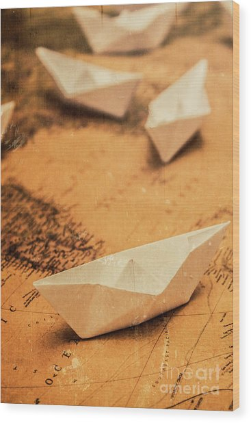Closeup Toned Image Of Paper Boats On World Map Wood Print