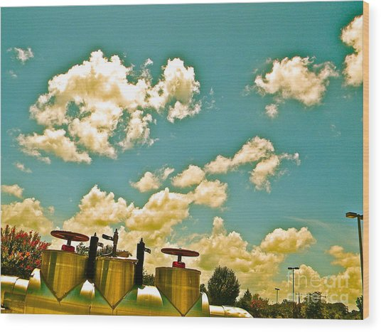 Clouds Over Oil Field Equipent Wood Print by Chuck Taylor