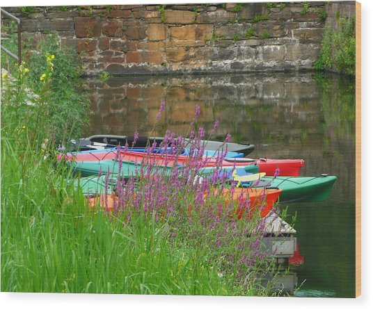 Colorful Kayaks Wood Print