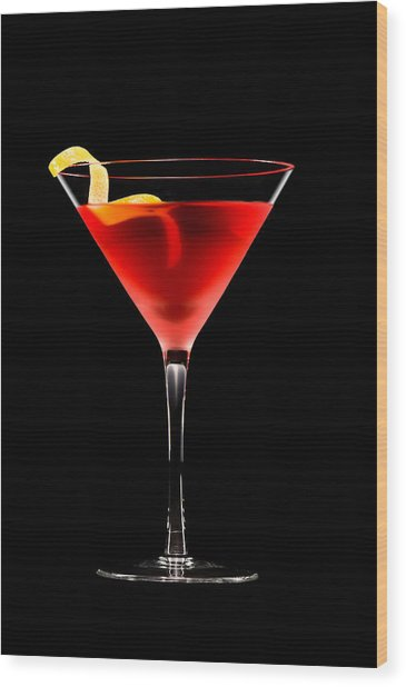 Cosmopolitan Cocktail In Front Of A Black Background  Wood Print