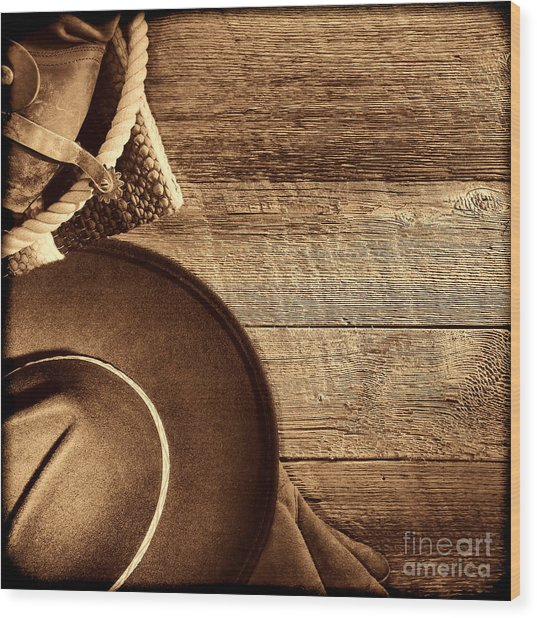 Cowboy Hat And Gear On Wood Wood Print