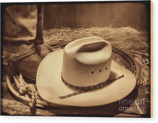 Cowboy Hat On Barn Floor Wood Print