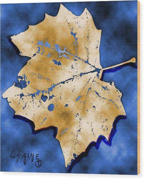 Dancing Tan Leaf Wood Print by Carolyn Saine