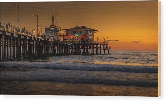 Daylight Turns Golden On The Pier Wood Print