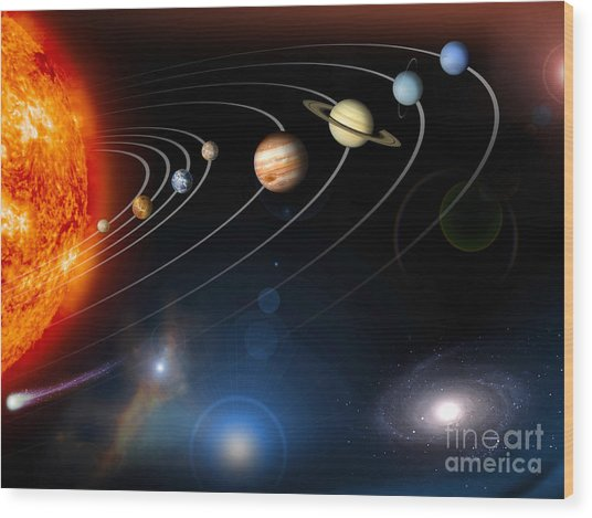 Wood Print featuring the digital art Digitally Generated Image Of Our Solar by Stocktrek Images
