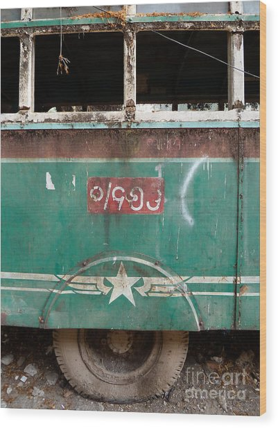 Dilapidated Vintage Green Bus In Burma - Side View With Tire Wood Print