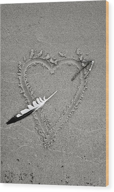 Feather Arrow Through Heart In The Sand Wood Print