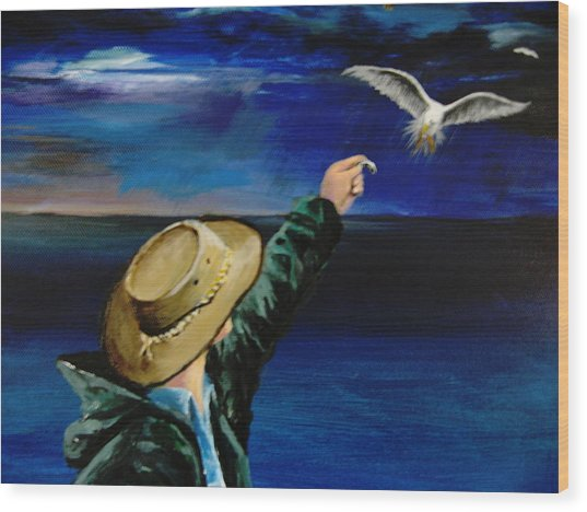 Feeding My Gull Friend Wood Print by Larry Whitler