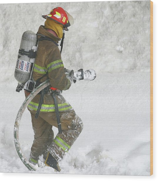 Firefighter In The Snow Wood Print by Jack Dagley