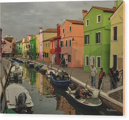 Fisherman At Work In Colorful Burano Wood Print