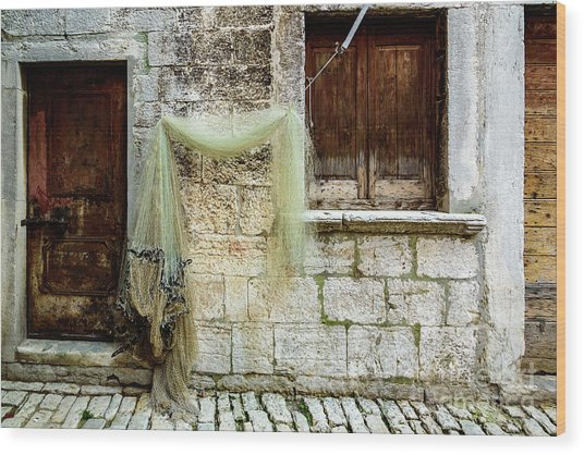 Fishing Net Hanging In The Streets Of Rovinj, Croatia Wood Print