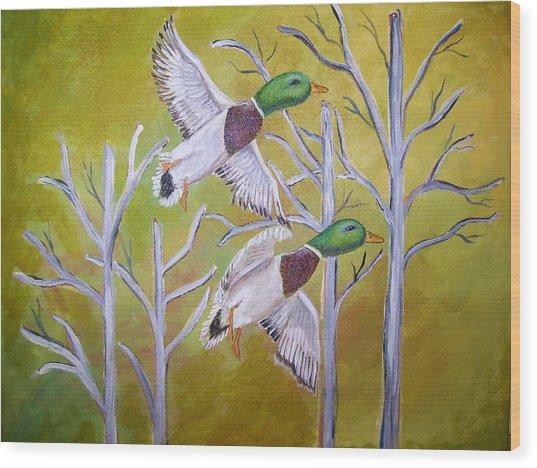 Flying Mallards Wood Print