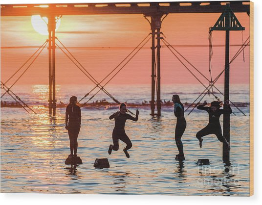 Four Girls Jumping Into The Sea At Sunset Wood Print