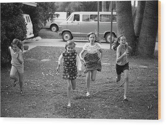 Four Girls Racing, 1972 Wood Print