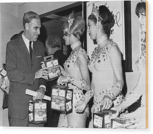 Fredric S. Berman Accepting A Box Of The Famous Nathan's Franks From Three Lovely Rockettes . 1966 Wood Print