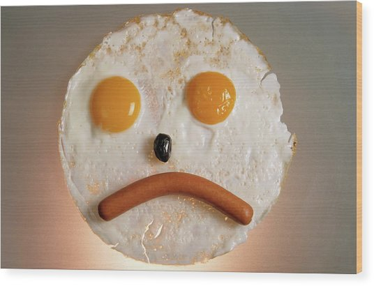 Fried Breakfast Of Eggs And Sausage Made Into A Frowning Face Wood Print by Sami Sarkis