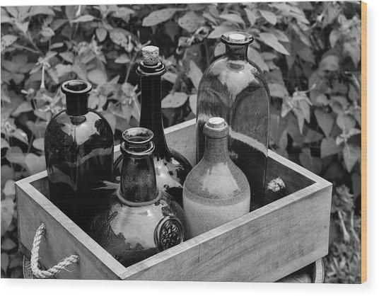 Glass Bottles In The Garden Wood Print