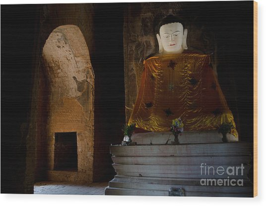 Gold Shrouded Buddha In Burma Basks In Natural Light By Temple Portal Wood Print